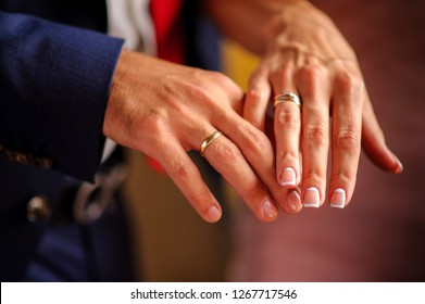The groom's hand and the bride's hand with wedding ring Closeup