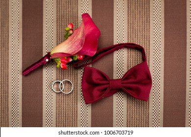 Groom's morning. Wedding accessories. Shoes and wedding bouquet, rings, boutonniere and a belt