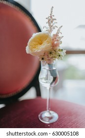 Groom's orange blossom with rose and wild flowers waiting for groom in a glass of water