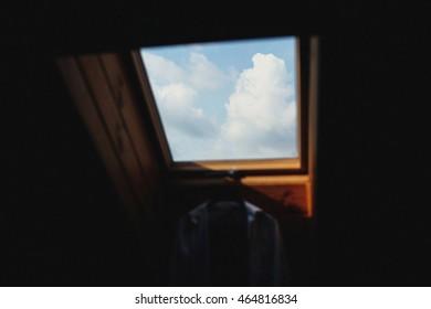 Groom's shirt hanging on window