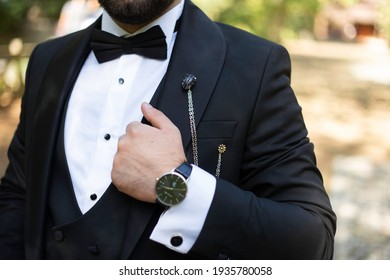 groom's wristwatch and jacket detail