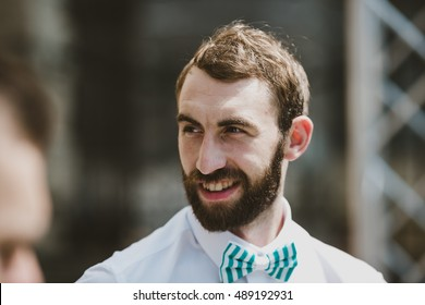 The groomsman stands near church