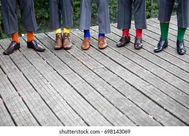 groomsmen legs with bright socks