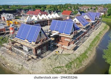 GROOTEBROEK , HOLLAND - 25 MEI 2021: Drone photo of under construction houses without roof tiles