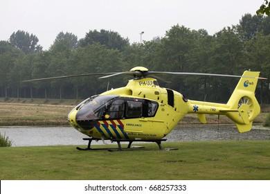 GROOTEBROEK, THE NETHERLANDS - JUNI 28,2017 :Just landed dutch ambulance helicopter on juni 28 , 2017 in Grootebroek, Holland