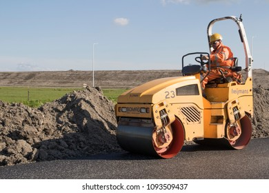 GROOTEBROEK , THE NETHERLANDS – May 3 , 2018 :Men worker on a Asphalt roller used for the construction of a new road