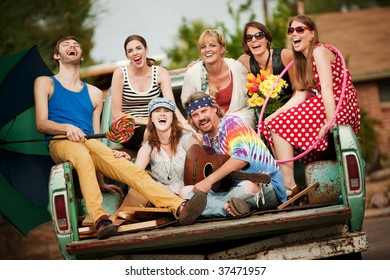 Groovy Group in the Back of Truck Laughing