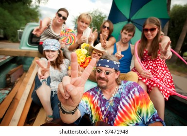 Groovy Group in the Back of Truck Making Peace Signs