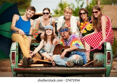 Groovy Group in the Back of Truck Smiling