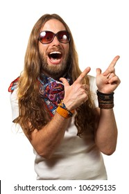 Groovy and happy young man dressed like a hippie pointing at copy-space. Isolated on white.