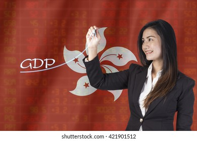 Gross Domestic Product (GDP) improvement concept. Businesswoman draw accelerating line of growing gdp.on Hong Kong Flag background