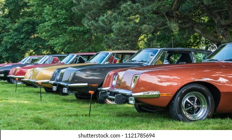 GROSSE POINTE SHORES, MI/USA - JUNE 17, 2018: Five Avanti cars, including a 1980 Avanti II, at the EyesOn Design car show, held at the Edsel and Eleanor Ford House, near Detroit, Michigan.
