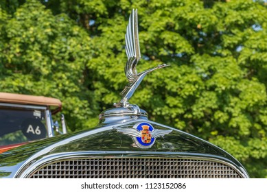 GROSSE POINTE SHORES, MI/USA - JUNE 17, 2018: Close-up of a 1932 Cadillac V-12 Dual Cowl Swan hood ornament at the EyesOn Design car show, at the Edsel and Eleanor Ford House, near Detroit, Michigan.
