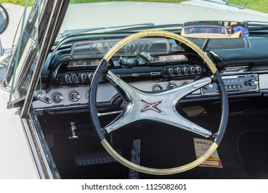 GROSSE POINTE SHORES, MI/USA - JUNE 17, 2018: Close-up of a 1960 Dodge Polara dashboard with push button transmission at the EyesOn Design show, at the Edsel and Eleanor Ford House, near Detroit.