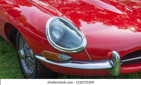 GROSSE POINTE SHORES, MI/USA - JUNE 17, 2018: Close-up of a 1963 Jaguar E-Type recessed headlight at the EyesOn Design car show, held at the Edsel and Eleanor Ford House, near Detroit, Michigan.