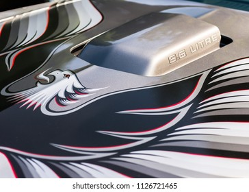 GROSSE POINTE SHORES, MI/USA - JUNE 17, 2018: Close-up of a 1979 Pontiac Firebird Trans Am 6.6 Litre hood scoop and screaming chicken logo car at the EyesOn Design car show.