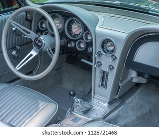 GROSSE POINTE SHORES, MI/USA - JUNE 17, 2018: Close-up of a 1963 Chevrolet Corvette dashboard at the EyesOn Design car show, held at the Edsel and Eleanor Ford House, near Detroit, Michigan.