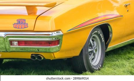 "GROSSE POINTE SHORES, MI/USA - JUNE 21, 2015: A 1970 Pontiac GTO ""The Judge"" car (named from a Sammy Davis, Jr. TV show ""Rowan & Martin's Laugh-In"" comedy routine) at the EyesOn Design car show."