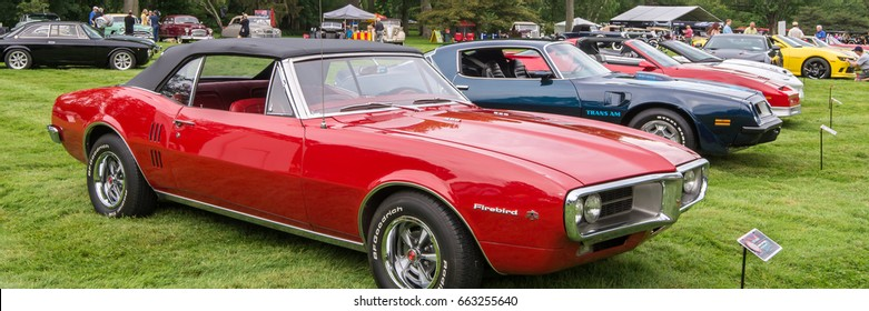 GROSSE POINTE SHORES, MI/USA - JUNE 18, 2017: A 1973 Pontiac Firebird and 1974 Trans Am car at the EyesOn Design car show, held at the Edsel and Eleanor Ford House, near Detroit, Michigan.