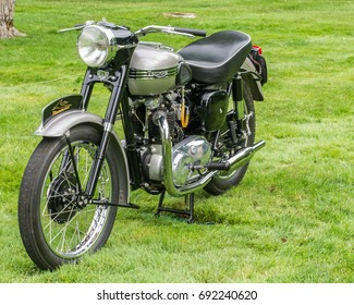 """GROSSE POINTE SHORES, MI/USA - JUNE 18, 2017: A 1956 Triumph 6T Thunderbird motorcycle with """"paper dart"""" logo at EyesOn Design, held at the Edsel and Eleanor Ford House, near Detroit, Michigan."""