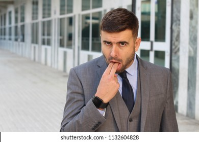 Grossed out businessman about to puke