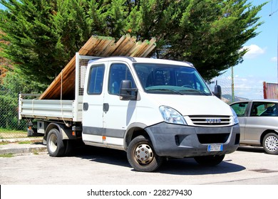 GROSSETO, ITALY - AUGUST 1, 2014: White cargo truck Iveco Daily at the city street.