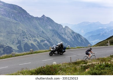 Grossglockner, Austria, 23 July 2015: Cyclist and motorcyclist on uphill road, Eastern Alps