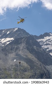 Grossglockner, Austria - Aug 8, 2020: Emergency helicopter rescue ski accident in the mountain
