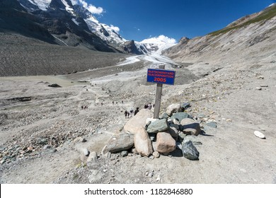GROSSGLOCKNER, AUSTRIA - AUGUST 21, 2010: View of melting Pasterze Glacier, Alps mountains, Austria. Table with glacier position of Pasterze Glacier in 2005 showing the result of global warming.