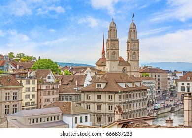 The Grossmunster with town hall in front. It is a Romanesque-style Protestant church in Zurich, Switzerland. View from park Lindenhof.