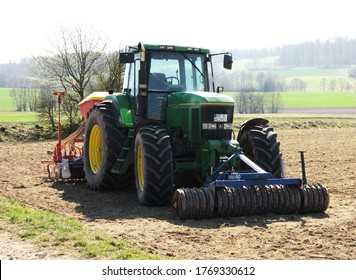 Grossropperhausen, Germany - April 6, 2020: John Deere 7800 in a field near the village of Grossropperhausen on April 6, 2020