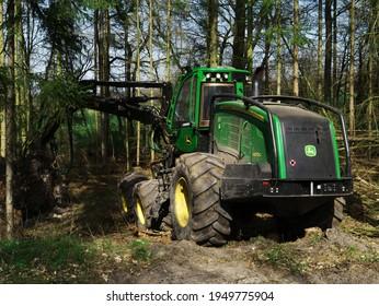 Grossropperhausen, Germany - March 16, 2021: The 1470G is John Deere's largest harvester model harvesting in the forest near the village of Grossropperhausen on April 4, 2021.