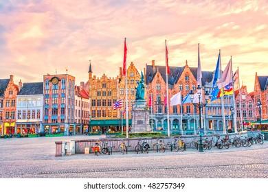 Grote Markt square in medieval city Brugge at sunset, Belgium.