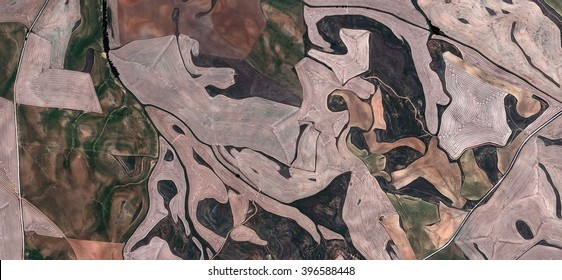 grotesques,abstract photography of the Spain fields from the air, bird's eye view, tribute to Pollock, artistic representation of human labor camps, abstract expressionism, contemporary art,