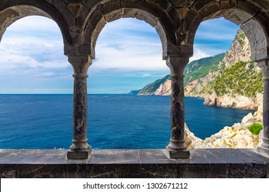 Grotta di Lord Byron, coast with rock cliff through external arch colonnade Church San Pietro, Portovenere, Ligurian sea, Riviera di Levante, National park Cinque Terre, La Spezia, Liguria, Italy