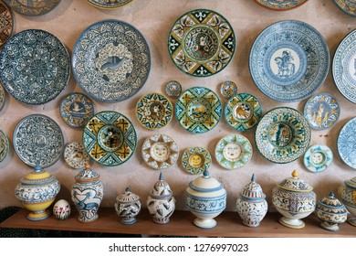 GROTTAGLIE, ITALY - JUNE 3, 2017: Painted plates a traditional ceramics shop in Grottaglie, Italy. Grottaglie is a famous handmade ceramics production town in the region of Apulia.