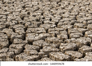 The ground in a barren stream  During the summer season. The soil is separated from hot and dry air.