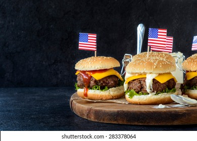 Ground beef mini burgers on wooden board,selective focus and blank space