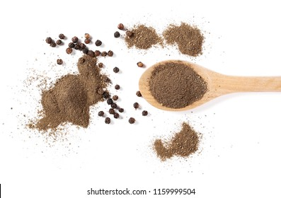 Ground black pepper powder and grains in wooden spoon, isolated on white background, top view