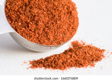 Ground Chipotle Pepper Spilled from a Teaspoon