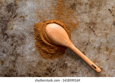 Ground Cinnamon Spilled from a Teaspoon