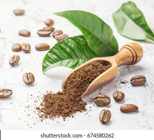 Ground coffee, beans and leaves