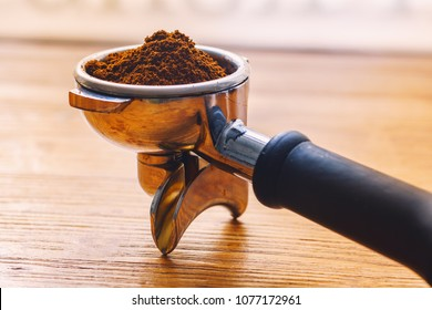 ground coffee in a holder