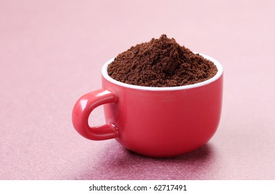 Ground coffee in a red cup