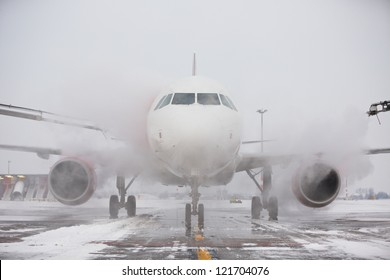 Ground crew of provides de-icing. They are spraying the aircraft, which prevents the occurrence of frost. Prague, Czech Republic.