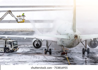 Ground crew provides de-icing. They are spraying the aircraft, which prevents the occurrence of frost