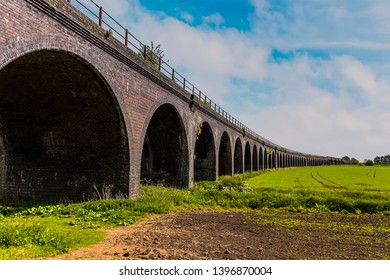 A ground level view of the abandoned railway viaduct at Fledborough, Nottinghamshire in springtime