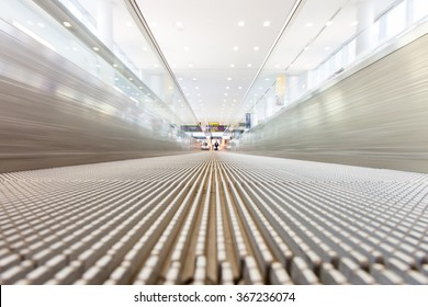 Ground level view of an airport slide walk.