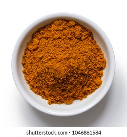 Ground ground masala spice mix in white ceramic bowl isolated on white from above.