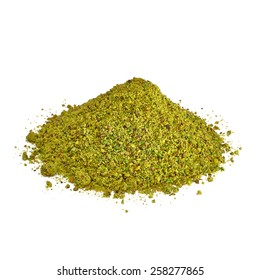 Ground, milled, crushed or granulated pistachio pile isolated on white background